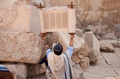 Lifting high the Torah at the Western Wall