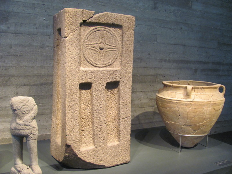 Storm god (left) and Temple Standing Stone, Tel Hazor, 15th-13th Century BC