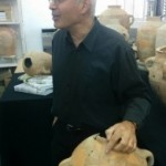 Professor Yosef Garfinkel of Hebrew University points to the Ishba'al inscription found in 2012 during excavations at Khirbet Qeiyafa (photo credit: Ilan Ben Zion/Times of Israel staff)