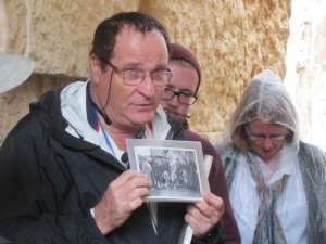 Shlomo and a picture of the 12 family members lost in Holocaust.