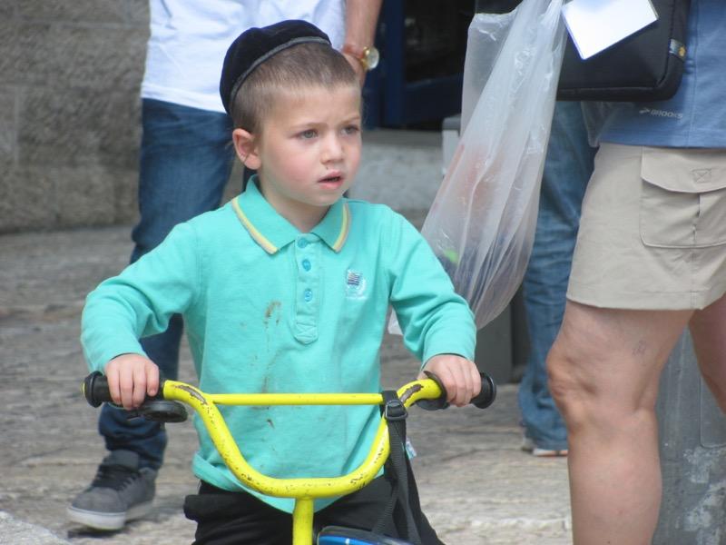 jewish boy riding bike jewish quarter jerusalem