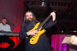 Hasidic Jew Menachem Herman playing guitar