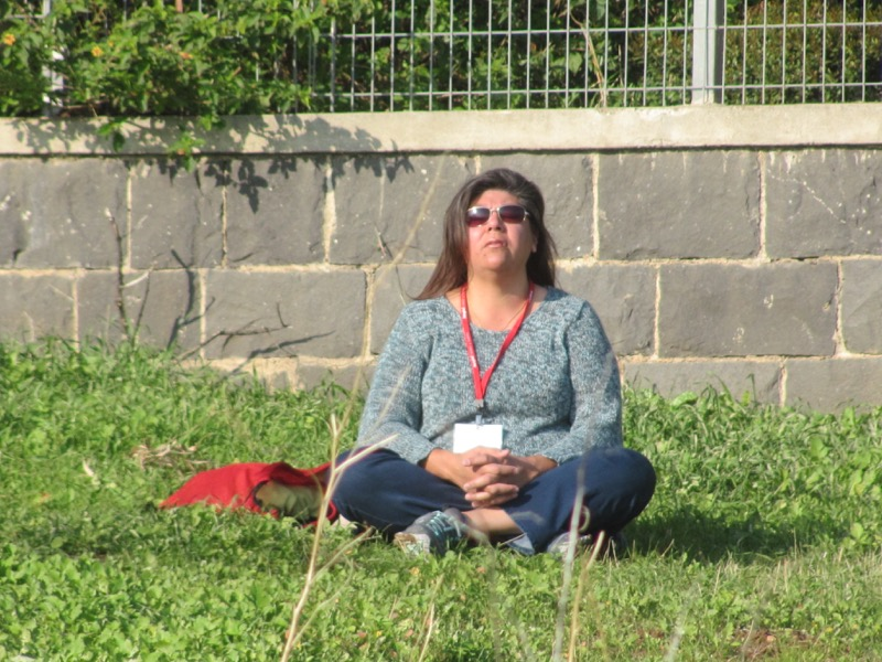 praying on Mt. of Beatitudes