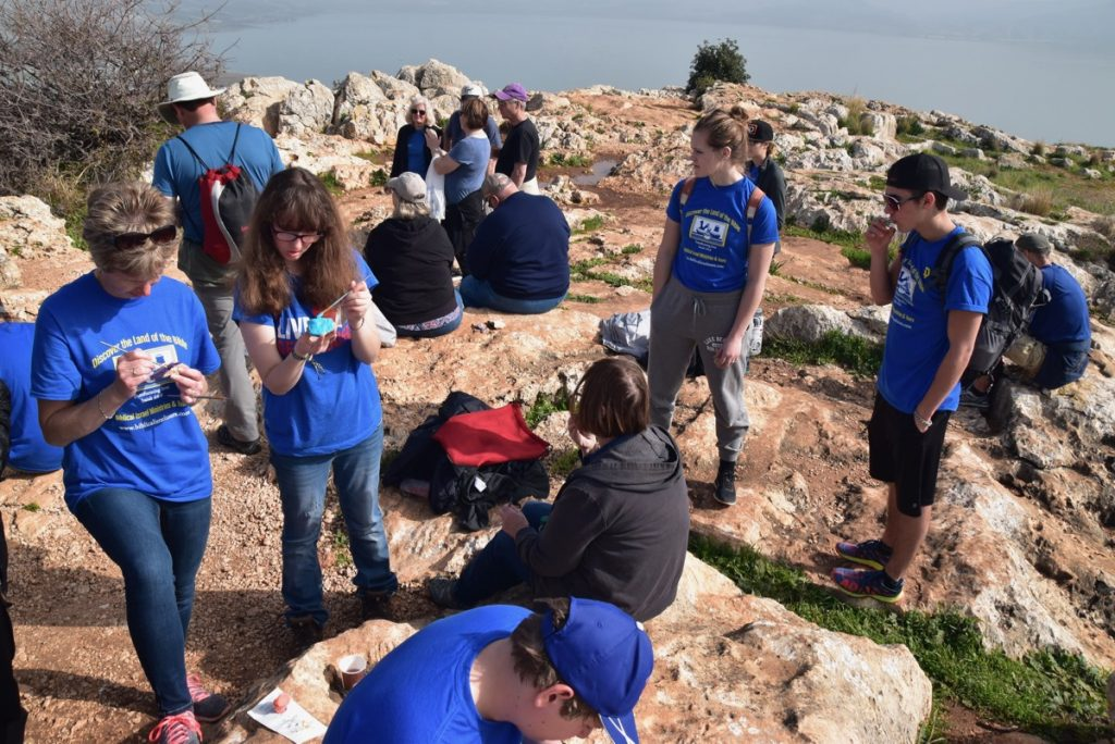 Arbel cliff painting stones January 2018 Israel Tour